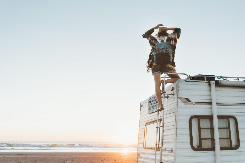 van lifestyle charming woman beach road trip Oregon coast