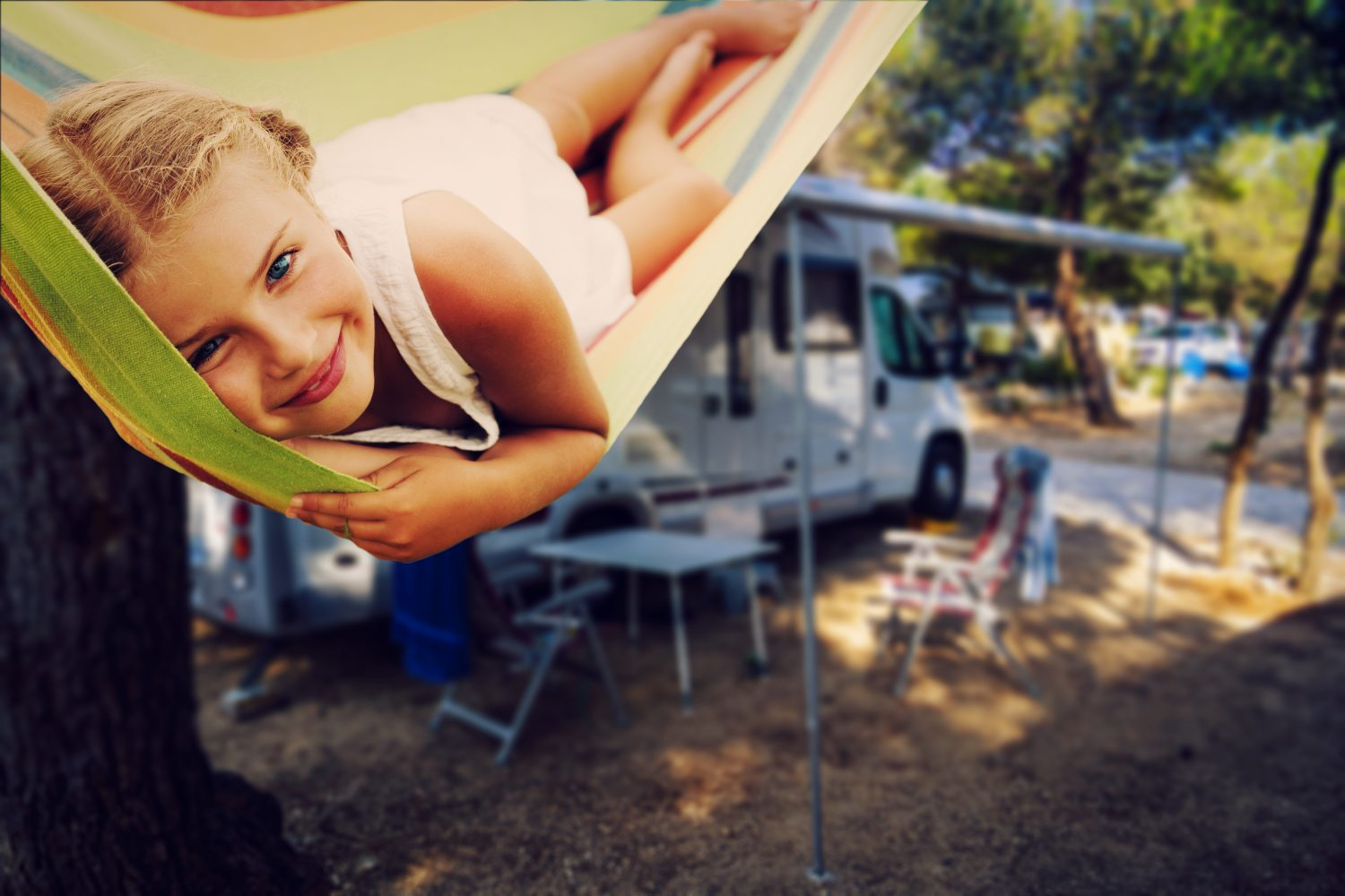 Smiling child enjoys a family RV vacation