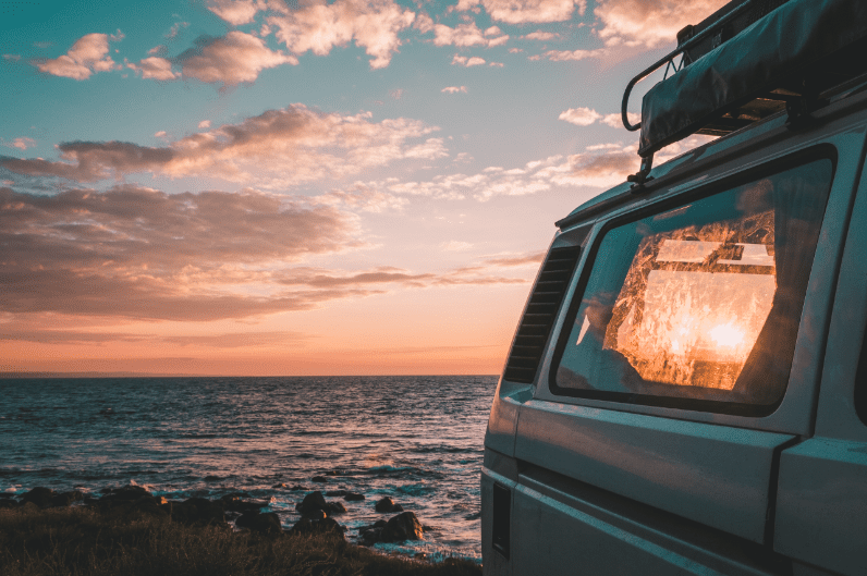 RV window with beach sunset in the background oregon coast bandon road trip
