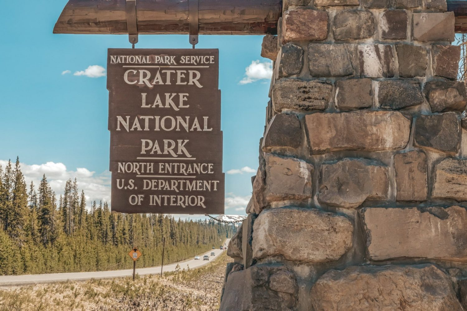 Crate Lake National Park north entrance sign located at entrance to the park