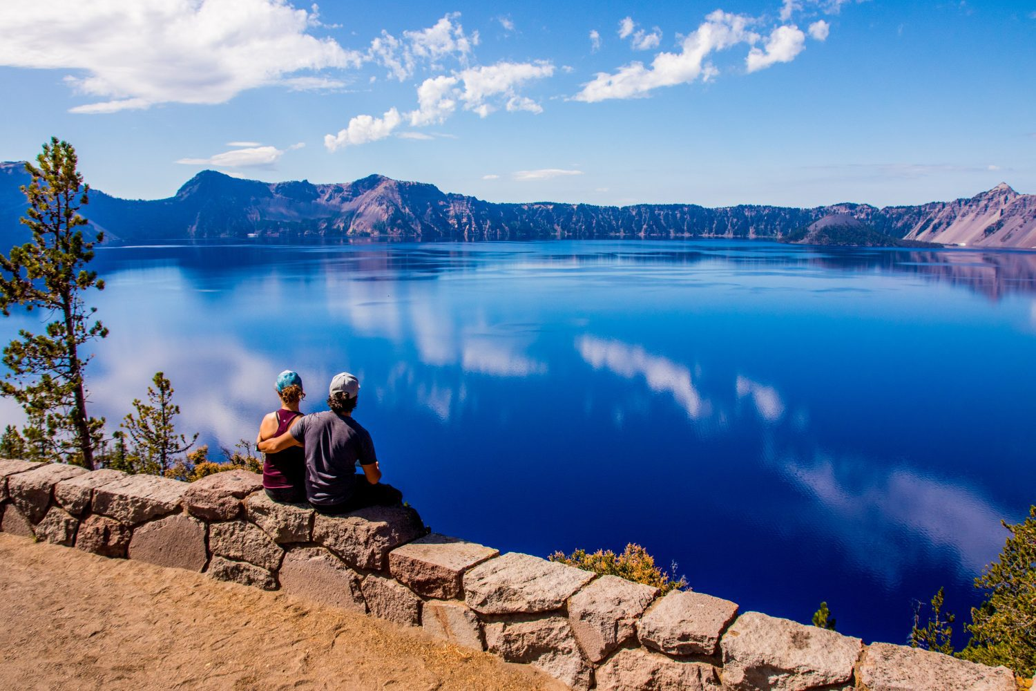 a young couple overlooking crater lake national park in oregon