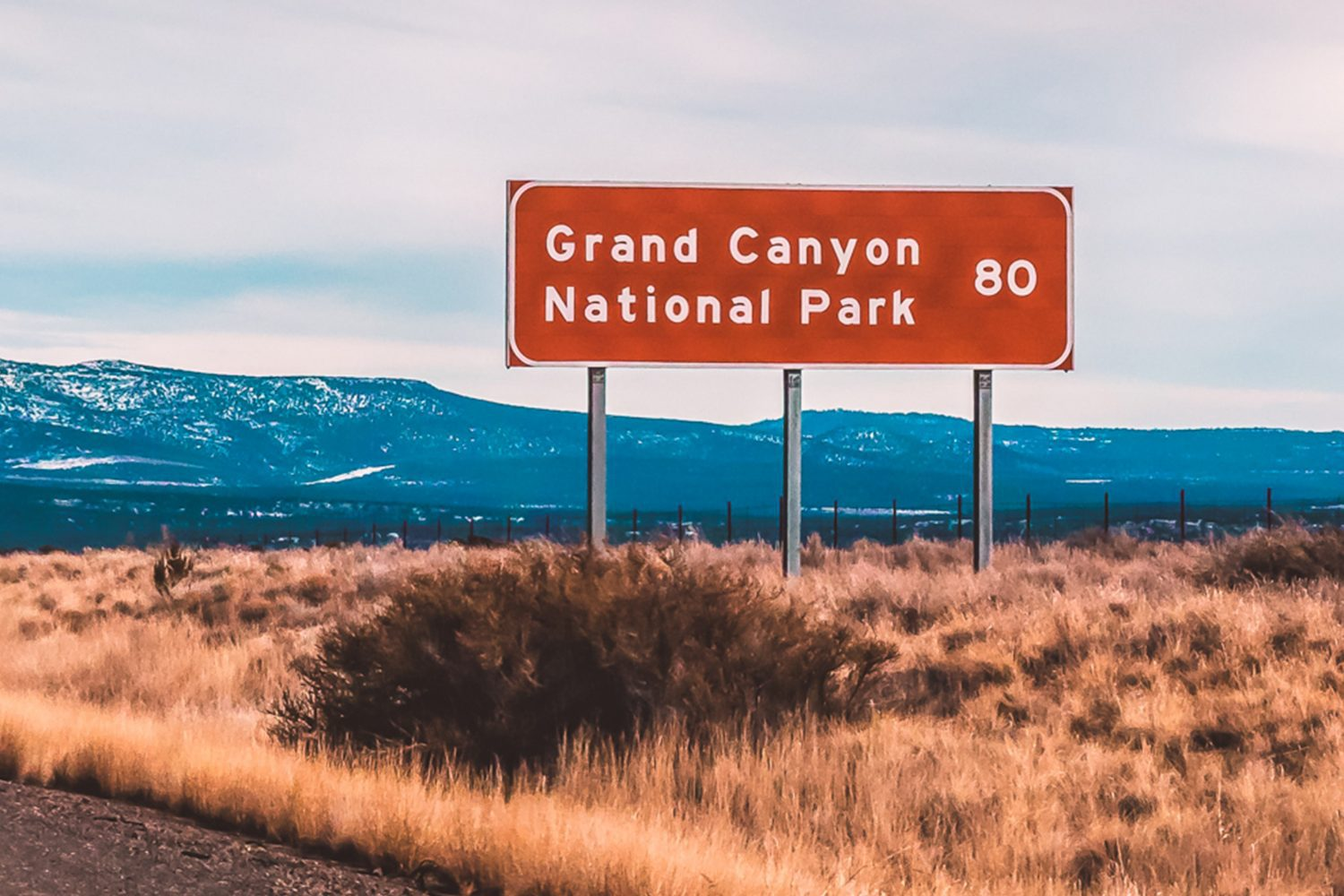 road sign noting that the grand canyon is 80 miles away