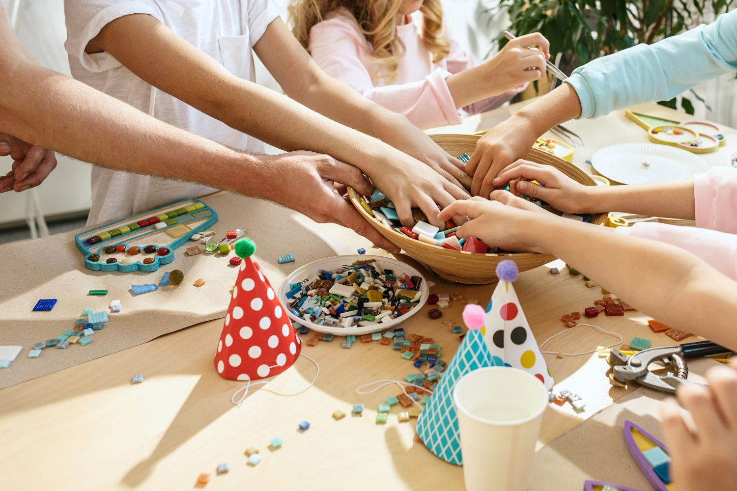 Kids interact in a mosaic puzzle arts and crafts activity during a birthday party